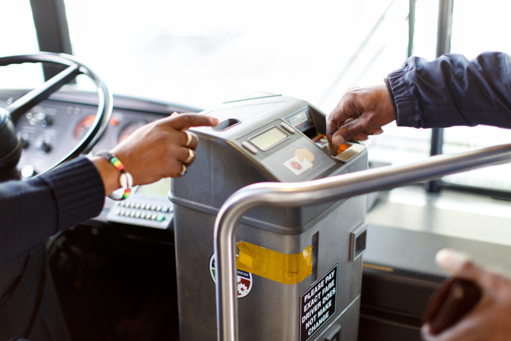 Image of hand paying fare